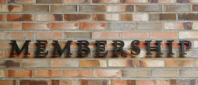 Membership Sign on Brick Wall