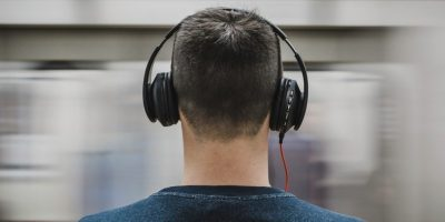 Guy in headphones, back of head