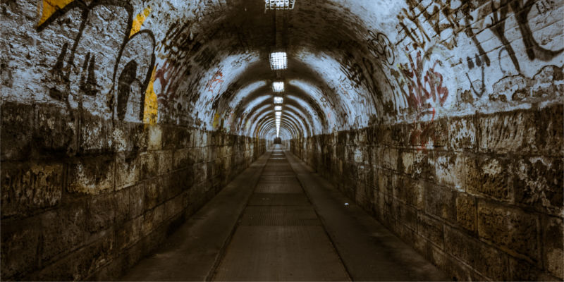 Tunnel with graffiti and lights